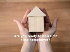 A creative template for a first-time buyers post. A background image of a wooden toy house with written text displaying 'Are you ready to be a first-time home buyer?