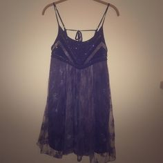 Sea Gypsy Mini Babydoll Dress - Urban Outfitters SOLD OUT  Super cute lace dress with sequin detail from Urban Outfitters ✨ worn once! Ties in the back Great condition! ❌ no trades  reasonable offers only please  Urban Outfitters Dresses Mini
