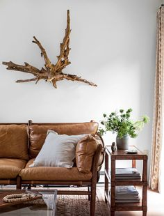 """Embrace unexpected objects to decorate your living room. Anything can be """"art,"""" so don't overlook pieces with texture and patina to add organic style to a space."""
