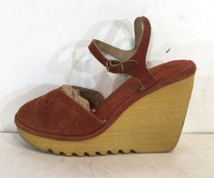 A classic of the 70s, the Cherokee platform sandal. These suede beauties have a very nice high wedge heel. Have circular patterns on the vamps. Very nice and clean.  Condition: excellent vintage condition. Worn very little. Label: Cherokee Circa: 1970s Composition: suede upper with vinyl lining, suede socklining, rubber sole Color: light brown Size: unlabeled so please go by measurements below Fits like: 5 (us) / 36 (eu) / 3 (uk) Measurements: Length of insole: 9.25 (23.4 cm) Width of…