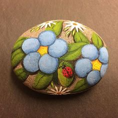 #Flowers and #Ladybugs. Painted on stone.