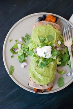 Sweet potato burrito with avocado sauce and sour cream from cookieandkate.com