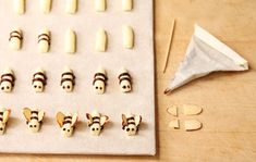 Buttercream bees.  If you add enough powdered sugar to buttercream you can use it to shape eyes, noses, etc. - No need for nasty fondant.