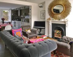 i like how the sofa is facing the fire place gray chesterfield sofa