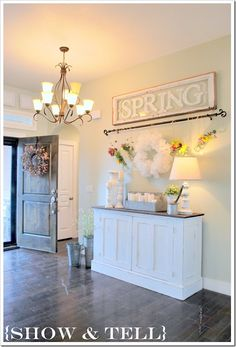 Like this with the rod with hanging items. Saw a heavier one with black buckets hanging above a table.