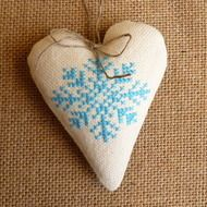 This heart would look absolutely stunning on a christmas tree or anywhere in your house. Front: Ivory canvas with blue snowflake cross stitch Back: checked fabric in shades of black, grey and blue. Natural twine attached for hanging. 10 cm high 8 cm wi...