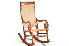 A classic colonial grandmother rocking chair handcrafted of teak wood, rattan caning seat and backrest
