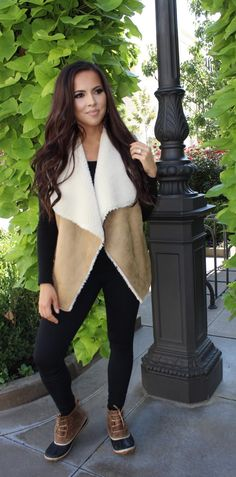 Faux Shearling vest, all black outfit and rain booties. Love this winter outfit!