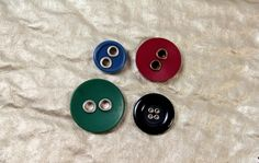 Metal rimmed button eyes