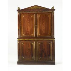 A FINE REGENCY BRASS-INLAID ROSEWOOD CLOTHES PRESS IN THE MANNER OF GEORGE OAKLEY, CIRCA 1810 in two parts, the upper section with cupboard doors opening to two mahogany-lined drawers, the lower section with cupboard doors opening to three mahogany-lined long drawers.  Upper section lacking six short drawers.