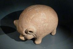 Majapahit Piggy Bank (Circa 15th Century) - The animal depicted is technically not a pig but the Javanese celeng, a small, swayed-back, black-skinned wild boar. Some theories suggest this design was exported from Indonesia to Europe, but that isn't likely