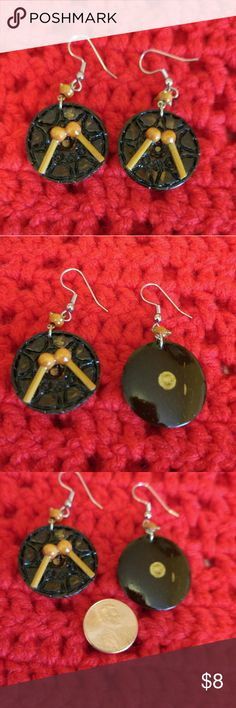 Coconut Shell Earrings These earrings are made to replicate the look of the top of a steel drum with paddles, played at almost all functions in T&T, West Indies and were handcrafted by a local street vendor in Trinidad using coconut shell. Jewelry Earrings