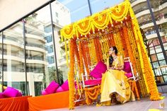 mehendi bridal seat , yellow genda flower decor , mehendi jhoola ,swings