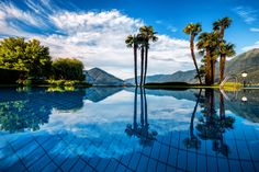 Hotel Eden Roc in Ascona, Switzerland, is located directly on the shore of Lake Maggiore. Beach Resorts, Hotels And Resorts, Paradise Pools, Hotel Eden, Hotel World, Leading Hotels, Tourist Spots, Cool Pools, Time Out
