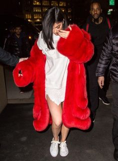 Kylie Jenner Photos Photos - Model and TV personality Kylie Jenner was spotted wearing a Valentine's red fur coat as she and boyfriend Tyga headed out in New York City, New York on February 14, 2017. - Kylie Jenner Heads Out For Valentine's Day With Tyga In NYC