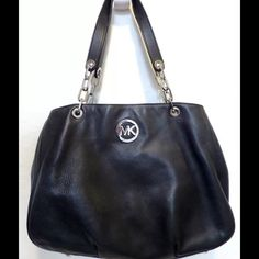 "Michael Kors Large Black Leather Chain Fulton Authentic Michael Kors Fulton Shoulder bag in black leather. Only a few months old. 100% genuine pebbled leather. Includes one large back exterior pocket with a magnetic snap closure. Dual leather and chain shoulder straps have a 9.5"" drop. Polished silver-toned hardware. Interior is fully lined in MK signature fabric and includes 3 compartments with a center zippered compartment. 14"" x 11"" x 5"". Michael Kors Bags Shoulder Bags"