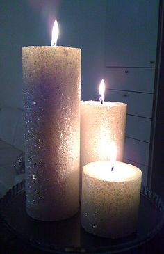 Glitter Candles... Wow! Sooooo perty! <3 HOW TO? Use Elmer's Glue with a big brush and then roll the candle in glitter.