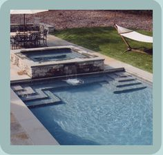 Love the way this hot tub is on the deck, but still flows into pool.
