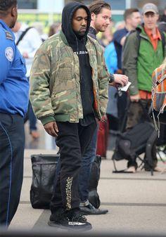 3441658a81550 Kanye West wearing Raf Simons Manics Camouflage Jacket