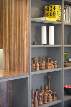 Cool Kitchen Design in Clean and Futuristic Interior Layout : Eye Cathing Decorative Accessories Displayed In Grey Open Shelving Designed In. Shelving Design, Open Shelving, Accessories Display, Decorative Accessories, Grey Shelves, Plastic Shelves, Futuristic Interior, Wood Vase, Cool Kitchens