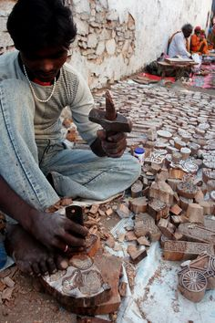 A craftsman makes wooden blocks of dye which are used in making print designs on Indian textiles. Shot in Pushkar in Rajasthan, India.