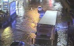 Major incident declared as coach passengers rescued after burst water main floods road creating a sink hole