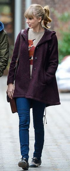 Bringing a whole new meaning to looking foxy, check out Taylor Swift,   skinny jeans, oxfords, rad purple parka with fox jumper.  Here's the game plan:  MUST: Free People Hardware Saddle Bag – $48  TRUST: TOPSHOP Tall Textured Parka Coat – $196  LUST: Peter Jensen Fox Intarsia Crew Neck – $290.24