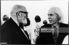 American photographers Ansel Adams (1902 - 1984) (left) and Minor White (1908 - 1976) talk at an Edward Weston exhibition at the Museum of Modern Art, New York, New York, January 27, 1975. (Photo by Fred W. McDarrah/Getty Images)