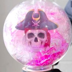 This crystal ball decoration for Halloween, made with an acrylic globe light cover, even displays a phantom apparition.