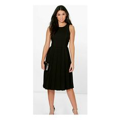Silvia Pleat Midi Dress has a round neck. Gorgeous sleeveless design. Pleated skirt from the waist down. The perfect dress for day or night wear
