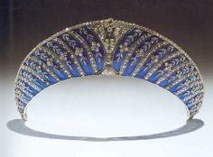 A tiara in the form of a traditional blue velvet kokoshnik made of platinum and enamel overlaid with diamond set forget-me-not flowers, standing for true love. Purchased by the 2nd Duke of Westminster from Chaumet in September 1911 for 375 pounds. It is set with 280 brilliant-cut diamonds and 314 rose-cut diamonds.