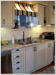 I really truly ADORE this kitchen!! I love the awning window covering and the bead board backsplash!! It is french country at its best!