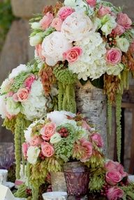 Birch vases filled with green amaranthus, hydrangeas, roses, and peonies