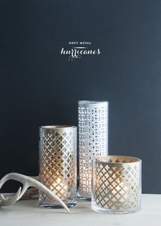 "Saw this ""radiator cover"" perforated metal at the store the other day and thought about making a hurricane. Today I saw this tutorial and I love the ease of just popping it into glass to make it super easy! - Punched Metal Hurricane DIY 