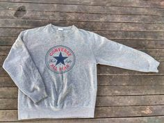 Check out this item in my Etsy shop https://www.etsy.com/uk/listing/503842152/converse-all-star-big-logo-sweatshirt