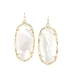 """The Elle Earrings are dainty show stoppers. This delicate earring creates an oval silhouette with a beautiful ivory mother-of-pearl stone. - 14K Gold Plated Over Brass - Size: 1.44""""L x 0.69""""W on earwi"""