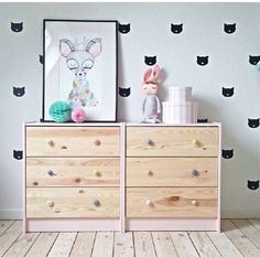 Pretty wall stickers and soft colours make this room perfect for baby. See the DIY version of the stamp at http://homeology.co.za/diy2/room-make-over-playing-with-wall-stamps/