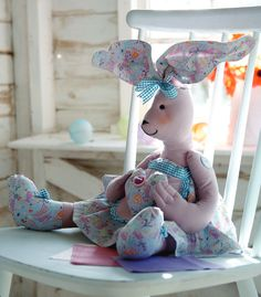 This delightful rabbit in her pretty pink pinny is showing how much she loves you! She has long bendy ears and her arms and legs are jointe...