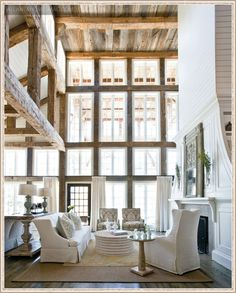 love the huge fireplace, the floor to ceiling window and the beautiful furniture.  Now if I could just convince my hubby