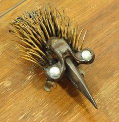 Porcupine found object sculpture dinosaur style by foundobjectart