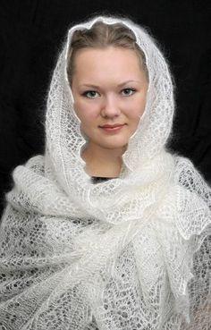A girl is dressed in Russian Orenburg shawl.