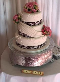 Cake by Emmabelle for our wedding. Ribbon from etsy to match bridesmaids dresses, flowers.. Dead by the town florist in Hemel Hempstead. Don't use. Scrabble DIYd by myself.