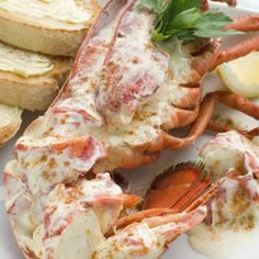 Choose a fresh garnish for poached lobster -- a sprig of Italian parsley adds a floral quality.