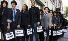 British musicians Miss Dynamite and Charlie Simpson stand in line outside a job centre