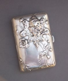 Sterling Silver Art Nouveau cigarette case. Exceptional Art Nouveau German, .800 repousse silver box, with flowers foliage and figure of a woman with flowing hair by Lutz & Weiss, Pforzhem, founded 1882.