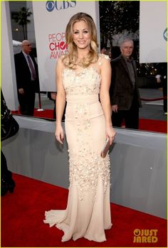 Kaley Cuoco dazzling in a richly embroidered nude mermaid dress at the 2012 PCA