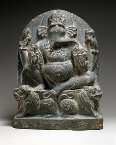 Ganesha Seated on a Lion Throne Date: ca. 10th century Culture: India Medium: Stone Dimensions: H. (image, from top of throne to bottom of base) 13 1/2 in. (34.3 cm); Gr. W. 10 1/4 in. (26 cm); Gr. D. 3 1/4 in. (8.3 cm) Tang: H. 6 in. (15.2 cm); Gr. W. 4 5/8 in. (10.8 cm); W. at bottom 4 1/4 in. (10.8 cm) Classification: Sculpture Credit Line: Gift of William and Bette-Ann Spielman, 1985 Accession Number: 1985.402