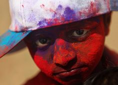 Colored powder covers the face of a boy in Mumbai on March 18. The main day of the holiday of Holi was Sunday, March 20, but participants fl...
