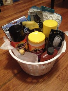 DIY gift for the men in your life.. Dollar store basket fill with car wash and
