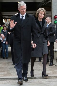 King Philippe and Queen Mathilde are pictured leaving Erasme Hospital on March 23, 2016 where they visited victims of the Brussels terrorist attacks. They also met some of the doctors who treated the injured.